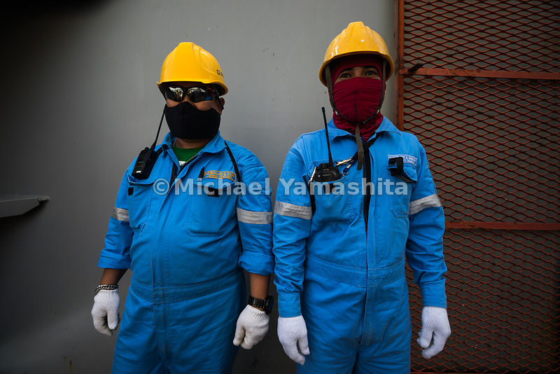 Decked in safety gear and a handy walkie-talkie, these port operators are ready for a busy day at work in Jurong Port.