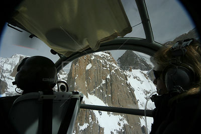 Rear view of pilot and director Vanessa Berlowitz  filming in the Karakoram Mountains, Himalayas, Pakistan. From Pakistani mi...