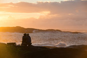 Couple enjoying the sunrise, Manafiafy Beach and Rainforest Lodge,  Sainte Luce Bay, Madagascar
