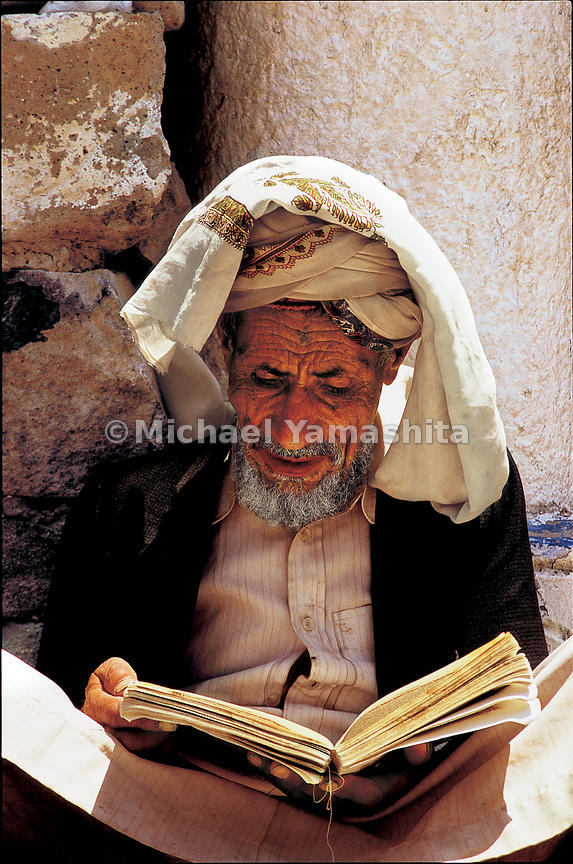 An elder reads the Koran at Jibla's Queen Arwa Mosque. The queen, who ruled Yemen in medieval times, left a rich legacy, buil...