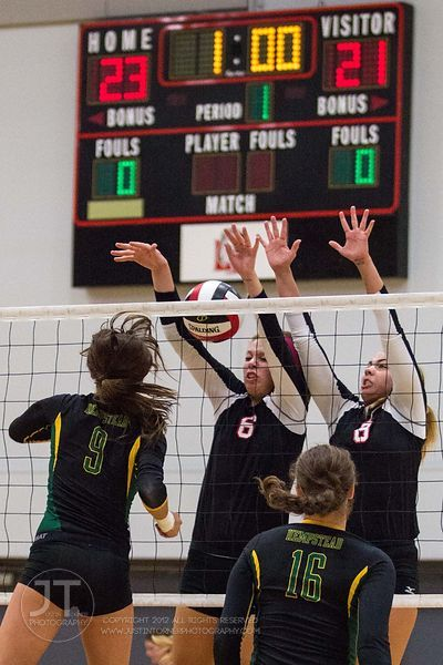 Linn-Mar's Megan Allmandinger (6) and Ashley Jones (8) go up to block versus Dubuque Hempstead's Heather Splinter (9) at the ...