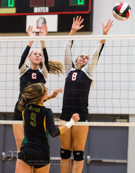 Linn-Mar's Samantha Boekhoff (2) and Ashley Jones (8) block a spike  versus Dubuque Hempstead at the 2012 Linn-Mar Varsity Vo...
