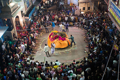 A crowd gets ready to start the bonfire on the obervance of Holika Dahan, Pushkar, Rajasthan, India