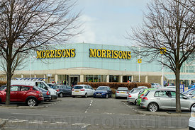 EDINBURGH, SCOTLAND – APRIL 16, 2016: Exterior view of the Morrisons supermarket and customer car park at the Gyle Centre loc...