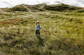 Danish girl playing in the dunes in Thy 15