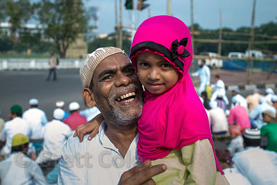 Muslim man and his granddaughter during Eid al-Adha, Red Road, Madian, Kolkata, India