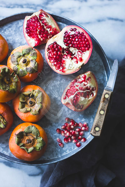 Fuyu Persimmons and pomegranate fruits