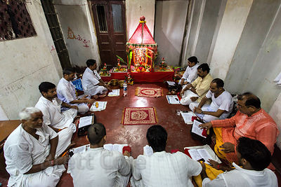 Hindu men pray and chant in Kalighat, Kolkata, India