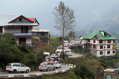 Tourist vans descend Rohtang Pass near Kothi, Manali, India