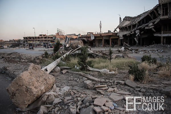 Prone lamposts lie flattened across the central reservation of the main road bisecting Kanisa District in West Mosul. Iraq, 4...