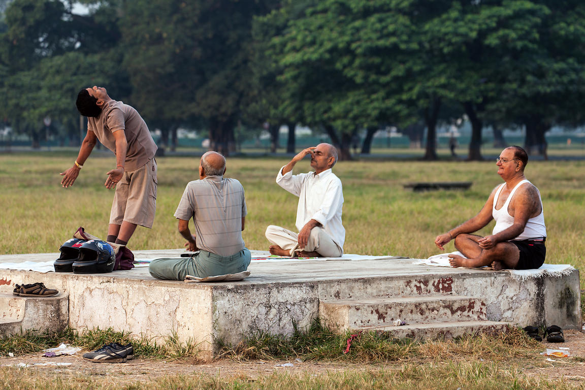 Men do yoga on the Maidan (Central Park), Kolkata, India.