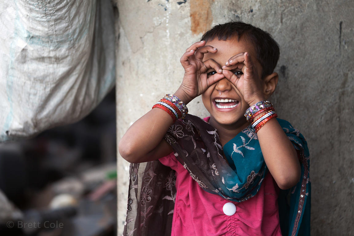 Girl at a recycling operation near Dhapa, Kolkata, India. Dhapa is the site of the main landfill for Kolkata.