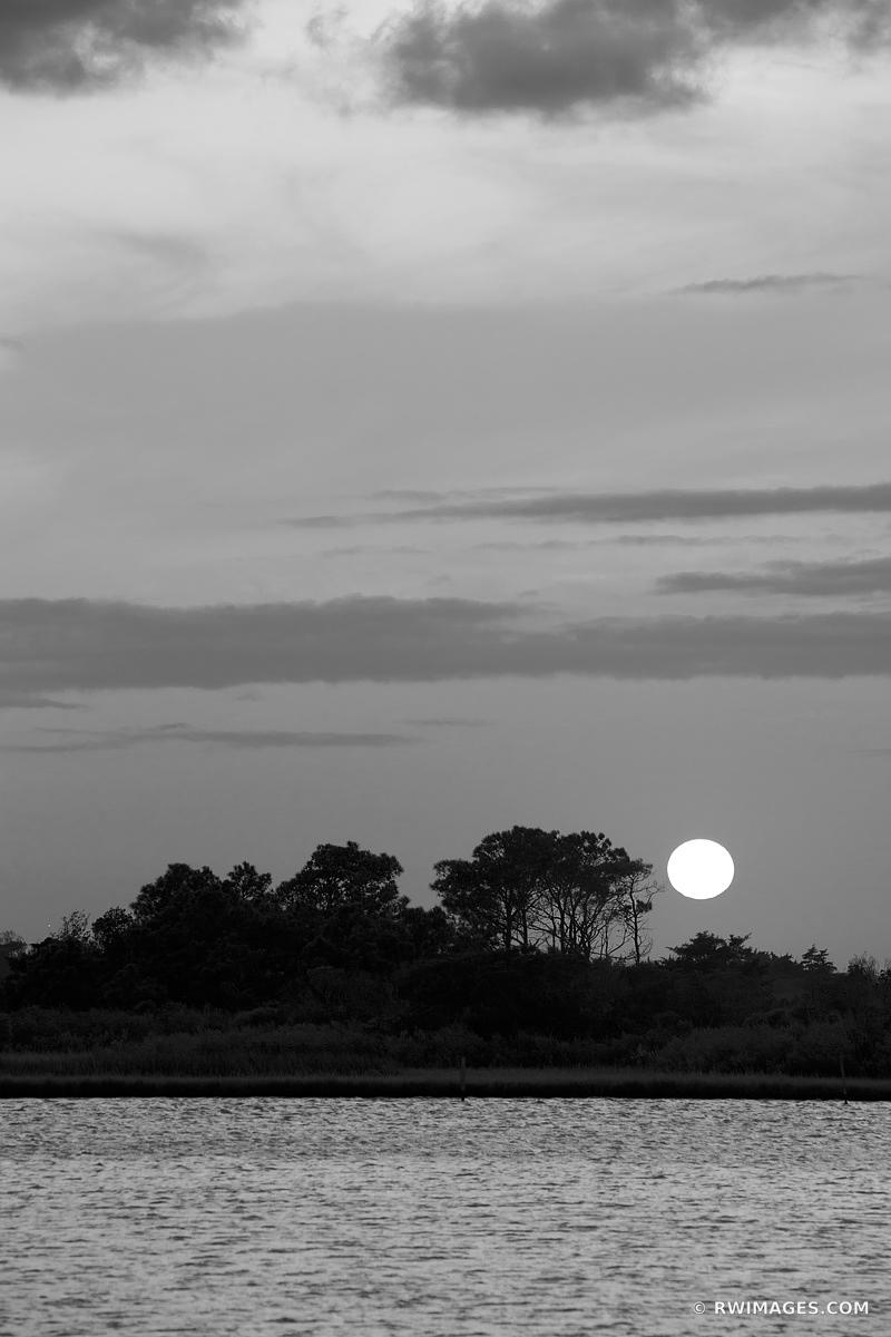 SUNSET OVER CHINCOTEAGUE BAY ASSATEAGUE ISLAND NATIONAL SEASHORE MARYLAND BLACK AND WHITE VERTICAL