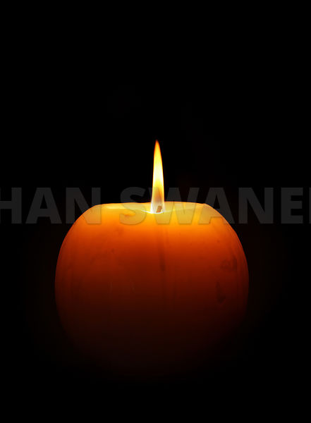 Burning candle against black (RM)