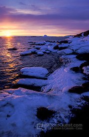 Ice-Covered Rock at Sunset