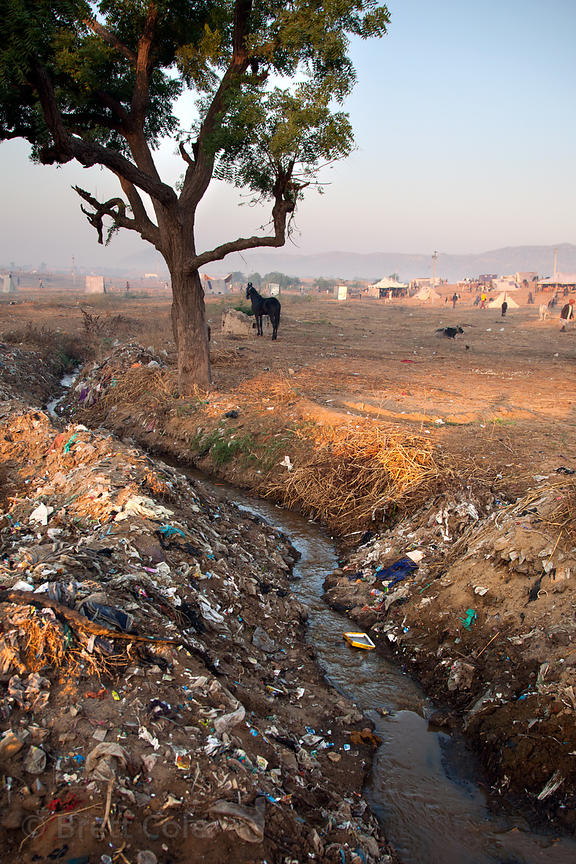 Trash along a waterway in Pushkar, Rajasthan, India