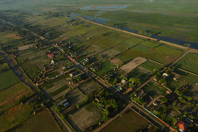 Aerial view over Letea village, within the Danube delta rewilding area, Romania, June 2012