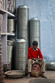 Boy working in a cookware shop in Jodhpur, Rajasthan, India