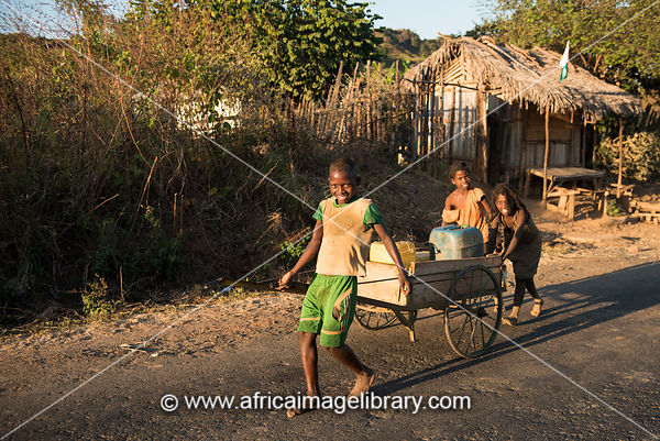 Children carting water to the village, Andranofasika, Madagascar