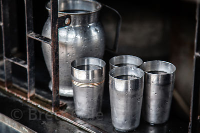 Metal cups used for water at a roadside stall in Mahim, Mumbai, India.