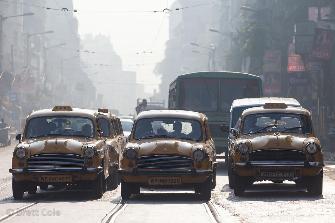 Early morning light on traffic near Howrah bridge, Kolkata, India.