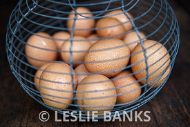 Organic brown eggs in a basket