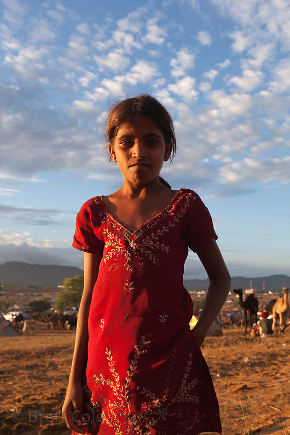 A girl from Pushkar poses in late afternoon sun, Rajasthan, India
