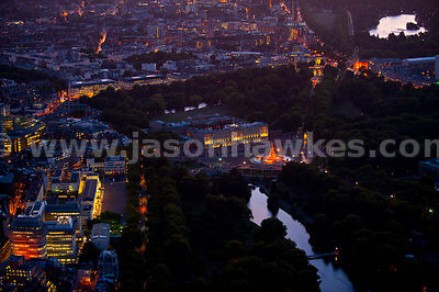 Aerial view over Buckingham Palace at night, London