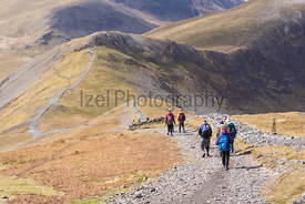 Hikers Walking from Grisedale Pike towards Hopegill Head in the Lake District