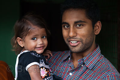 An NGO worker meets with a toddler who was treated for malnutrition, in the Fakir Bagan area of Howrah, India