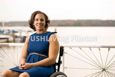 Young woman in a wheelchair on a marina dock