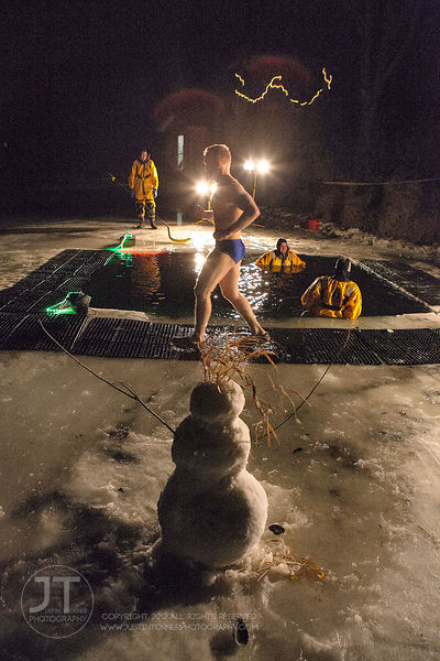 Luke Lofthouse makes his way to jump into the water during the Hawkeye Wrestling Club's Polar Plunge at the Brown Deer Countr...