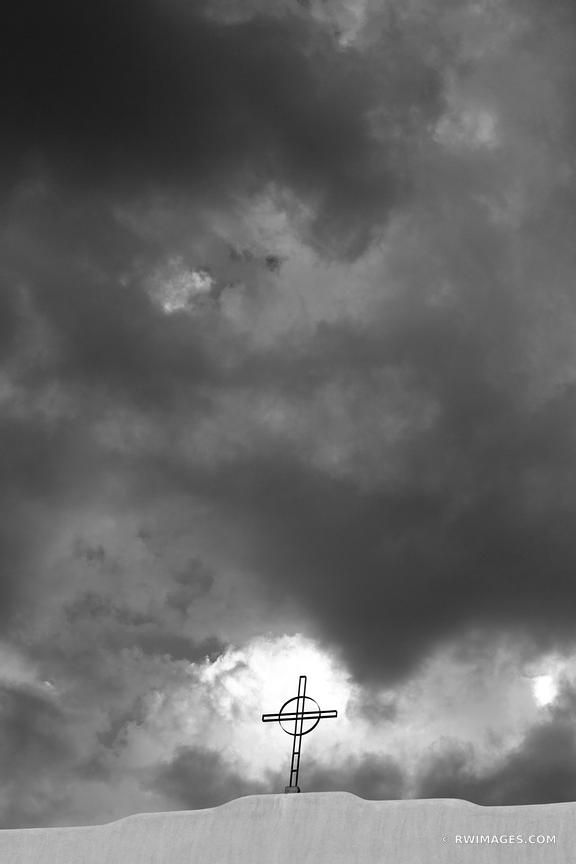 CROSS AND STORMY SKY SANTA FE NEW MEXICO ARCHITECTURE BLACK AND WHITE VERTICAL