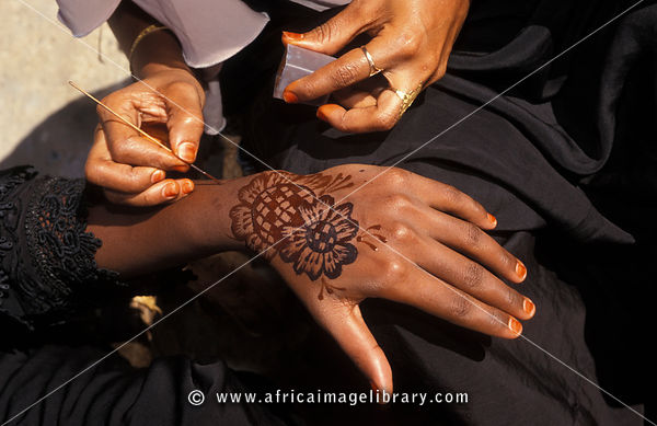 henna painting of hands and feet is an old tradition practised by Swahili women, Lamu, Kenya
