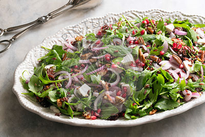 A healthy rocket, pomegranate and rice salad.