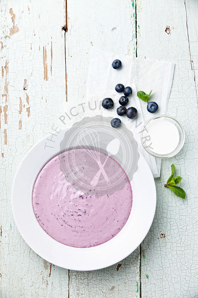 Sweet blueberry soup with cream