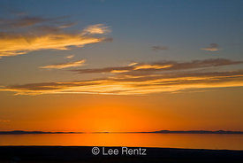 Dramatic and graphic sunset over the Great Salt Lake viewed from the Bridger Bay Campground, Antelope Island State Park, Utah...