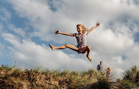 Danish girl jumping at Klitmøller beach