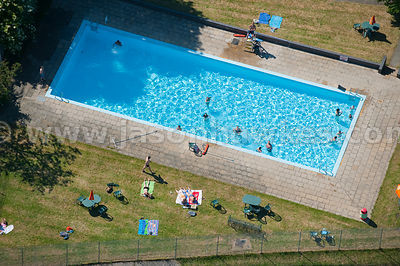 Aerial view of families in swimming pool