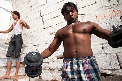 Weightlifters on the ghats along the Ganges River, Varanasi, India.