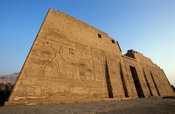 Medinet Habu, the first pylon is 63m long and decorated with bas-reliefs of victories of Rameses III, Luxor, Egypt