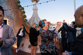 Tourists taking pictures on the roof of Casa Batllò in Barcelona, Spain.