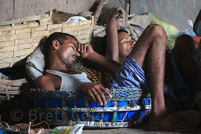 Workers rest at the Howrah Flower Market, Kolkata, India. It's the largest flower market in Asia.