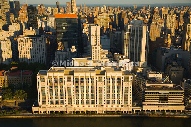 The renowned New York Presbyterian Hospital straddles the F.D.R. Drive along the East River.  Manhattan, New York City.