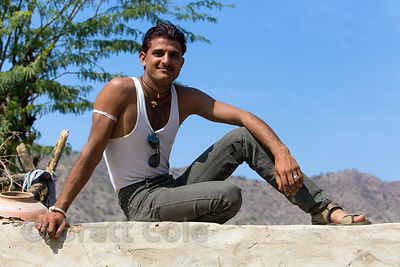 A farmer rests on a wall, Chainpura village, Rajasthan, India