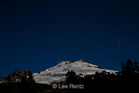 Mt. Baker lit by a full moon with stars shining above, viewed from the Railroad Grade Trail, Mt. Baker–Snoqualmie National Fo...