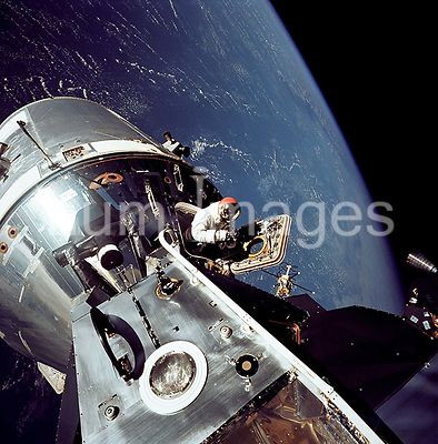 6 Mar 1969 - View of the docked Apollo 9 Command and Service Modules (CSM) and Lunar Module (LM), during astronaut David R. S...