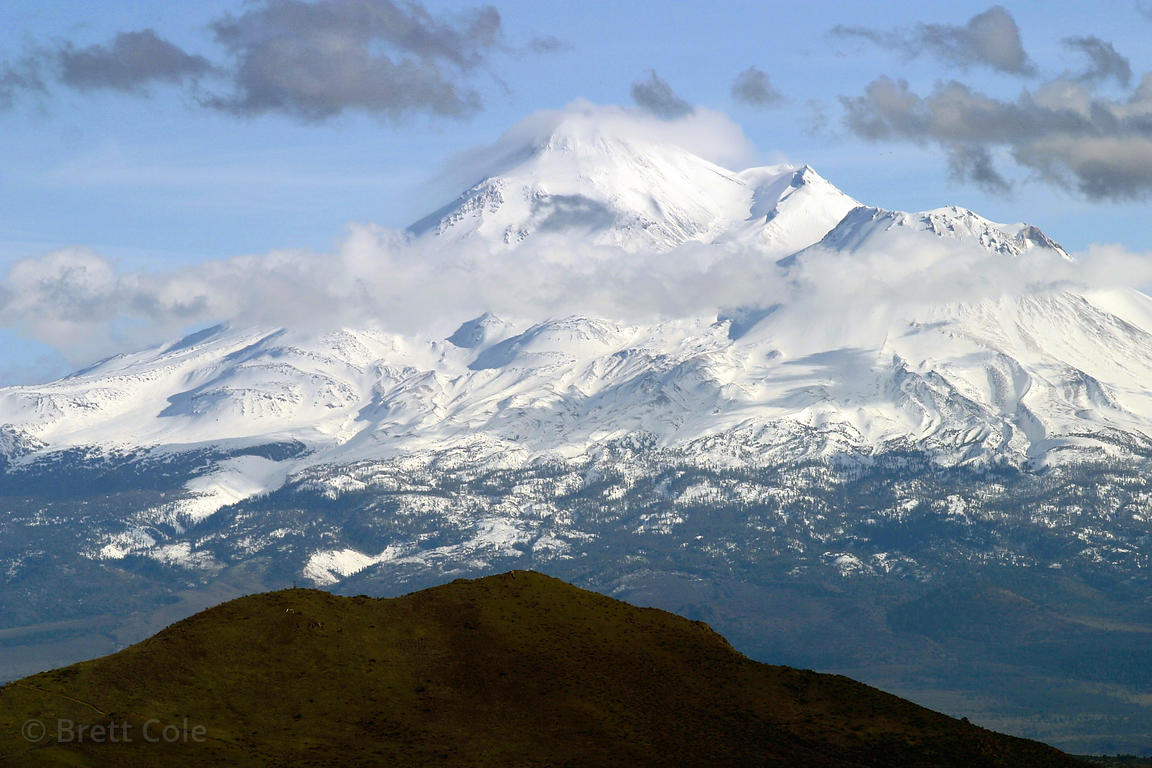 Mount Shasta rises 14,160 feet into the Northern California skies, with lenticular cloud formations around the summit.