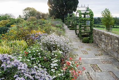 18th century raised walk with metalwork gazebos by Richard Overs being colonised by ivy gives views over surrounding countrys...