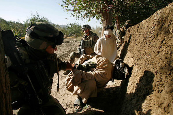 2008. 2008 Kapisa. Patrol in the village of Sediqkhel, Alasay valley with the 8th RPIMA. Two suspects have just been arrested...
